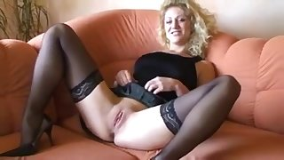German blonde has a dirty conversation masturbating her pussy