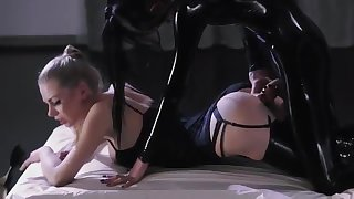 Two leather-clad lesbians strapon sex video